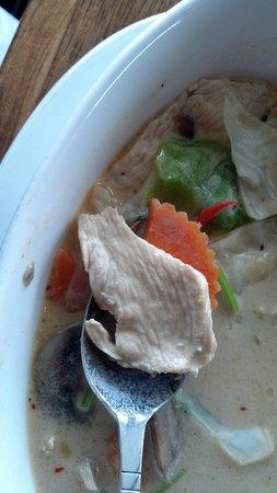 Thai Princess: Tom Kha, close-up of tender white meat chicken