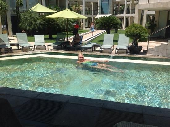 FuramaXclusive Ocean Beach: enjoying the pool