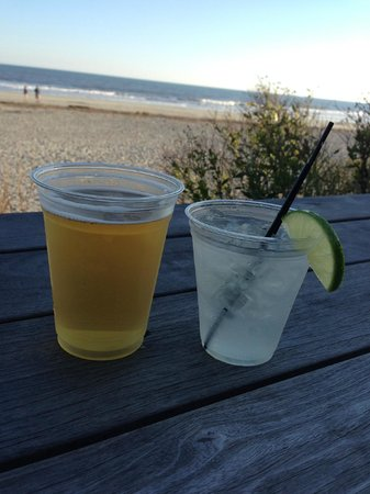 Tides Folly Beach: on the patio having a drink before dinner at Hank's
