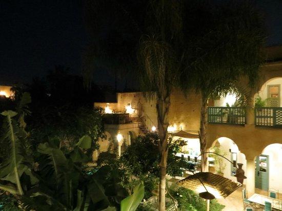 Palais Oumensour : The courtyard garden at night.