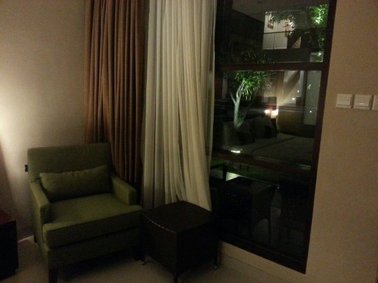 Amadea Resort & Villas: Sofa by the window overlooking the pool