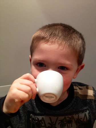 The Curious Table: My son enjoying the little cup of frothed milk
