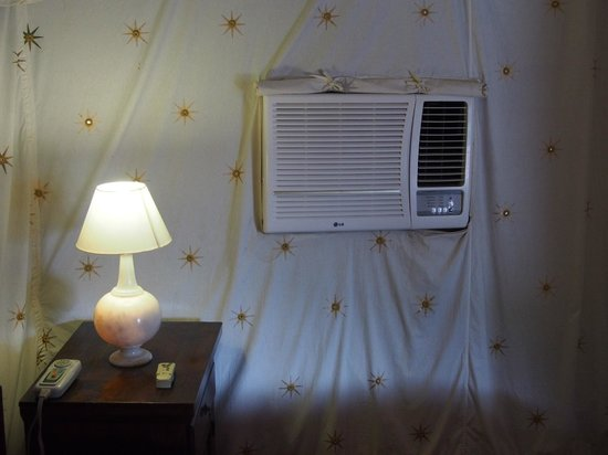 Orchard Hospitality Pvt Ltd: A/C in wall of bedroom