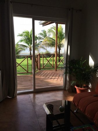 """Playa Tranquilo: Seating area/""""living room"""" with futon in cabana room"""