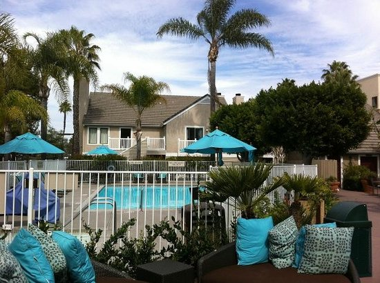 Residence Inn San Diego Central : Outside seating and pool with rooms in background.