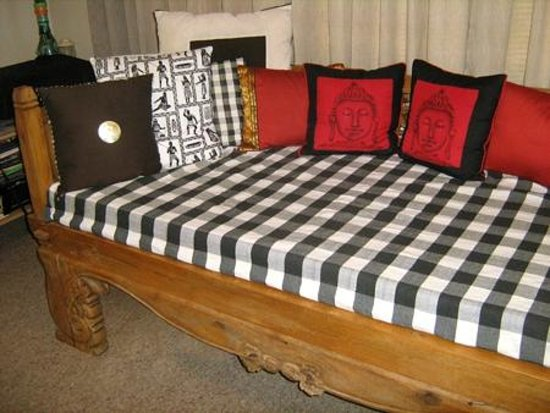 Guysers Gaystay: Balinese Day Bed in lounge - perfect for relaxing with a book