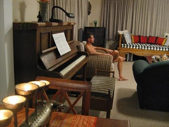 Guysers Gaystay: Guest lounge with piano, sofas, TV, Day Bed (clothing is optional indoors)
