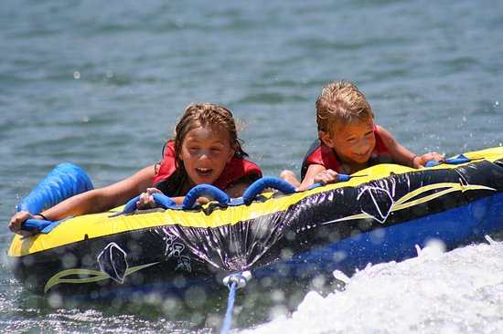 Bass Lake Water Sports Boat Rentals: Kids Having Fun on their Inner Tube