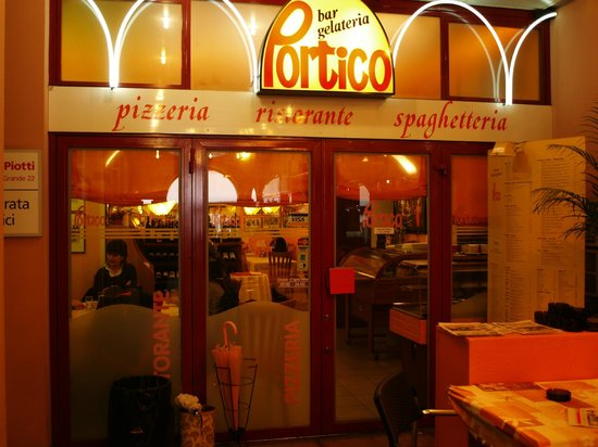 Al Portico: The restaurant entrance at the end of a short arcade