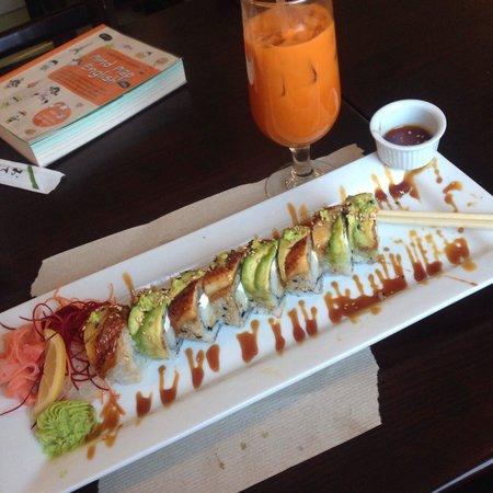 Thai Sushi Aroydee : Thai tea with black and white roll, so outrageously good! Eel, cream cheese, scallions, avocado