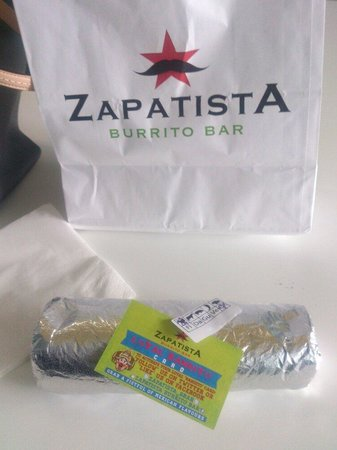Zapatista Burrito Bar: After unwrapped it, everything's just falling apart... The staff did not wrap it properly during