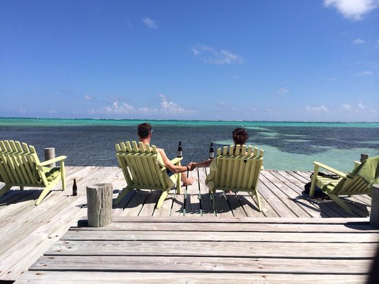 Caye Casa : Cute green chairs are great for relaxing on the dock.