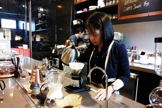 Three Little Birds Coffee: Barista brewing coffee