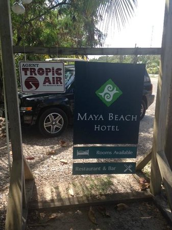 Maya Beach Hotel: Sign out front on the road