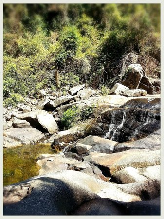 Telaga Tujuh Waterfalls: Water flowing through the rocks