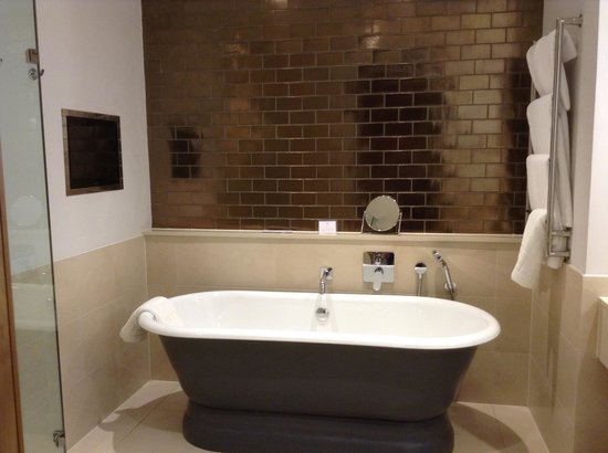 Rudding Park Hotel: Bathroom with beautiful roll top bath and tv