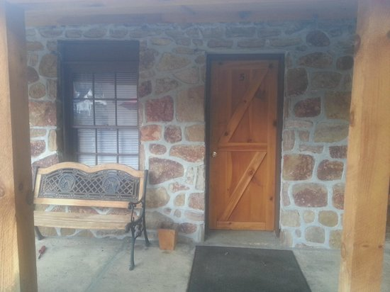 Creekside Court: Entrance to room, has a cabin/cottage look
