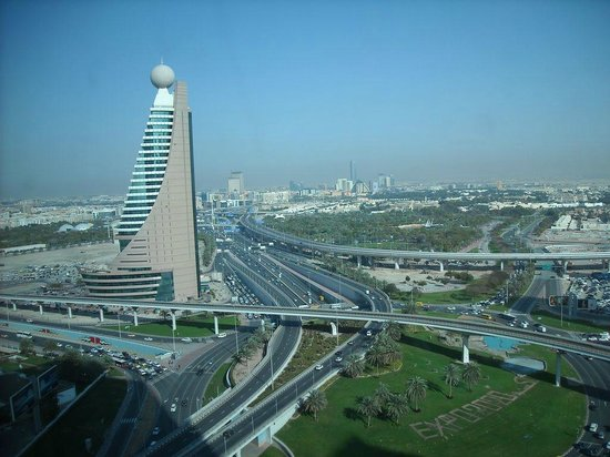 The H Dubai : View across the glass wall of the city facing room