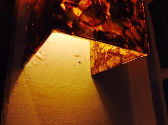 Nami Resort: Looks like the bathroom light hasn't been cleaned in a month, spider web with live spider