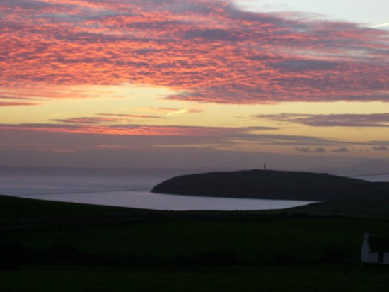 Mull of Galloway Holidays: View from East Muntloch Croft B & B Sunrise over the Mull of Galloway