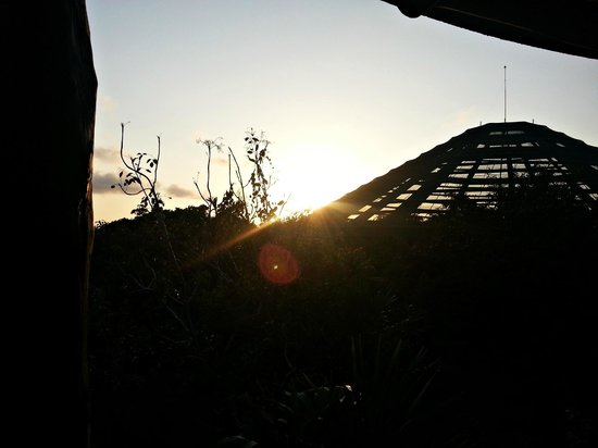 Bel Air Collection Xpu Ha Riviera Maya : The sun setting over the aviary, off our balcony