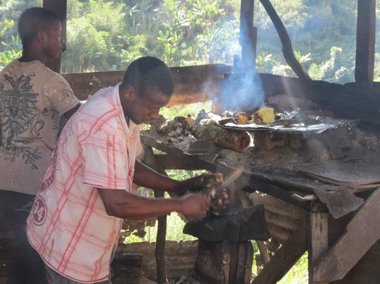 Kingsley's Take Care Tours - Day Tours: Friends of Kingsley's roasting Yam.