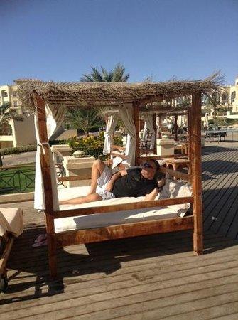 Cleopatra Luxury Resort Sharm El Sheikh: hubby chilling on sunbeds