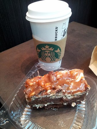 Cake and coffee while waiting at the airport Picture of Starbucks