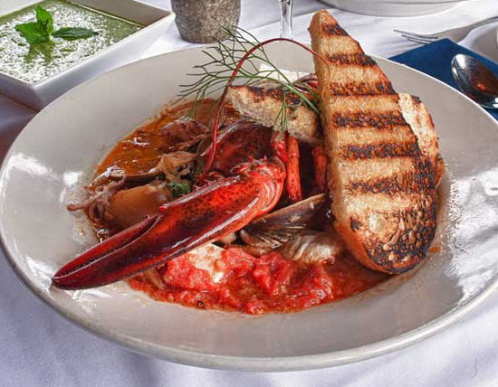 Pilgrim's Inn: Our signature seafood stew in a savory broth with grilled half lobster