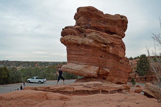 Holding up Balanced Rock at Garden of the Gods