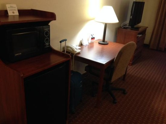 Holiday Inn Express: Room 410, microwave, large refrigerator and desk area.