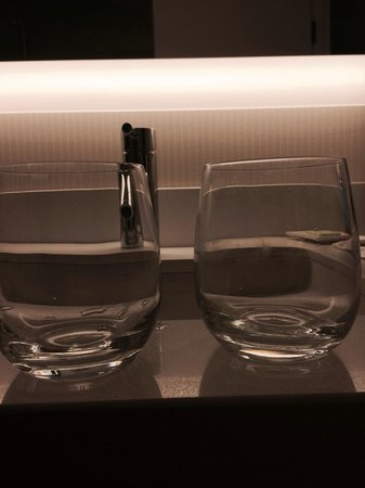 Hilton Mississauga/Meadowvale: Glass on the right is clearly rinsed wiped and returned the glass on the left was brought up whe