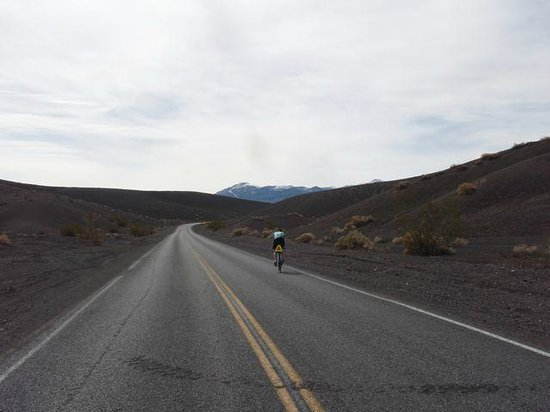 Ubehebe Crater: Biking up to Crater.  Note snow on the distant mountains.