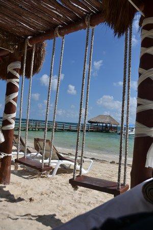 Azul Beach Resort Riviera Maya: View from beach cabana with swings.