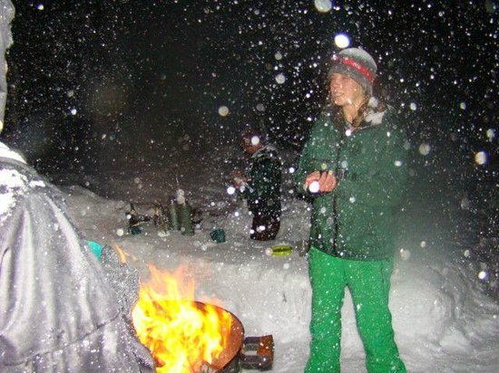 Wanderlust Tours: Stories at the bonfire - bar in the background