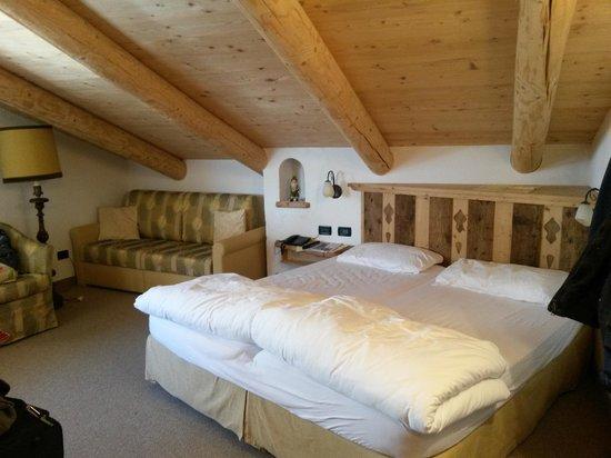 Arnica Mountain Hotel: camera in baita