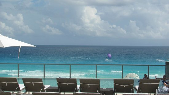 Secrets The Vine Cancun : View from upper deck pool