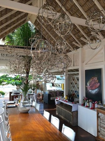 The Chili Beach Boutique Hotel & Resort: Dining area and poolside lounge