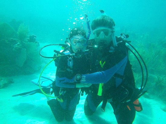 Captain Hook's Marina & Dive Center: PADI's newest diver and her dad!