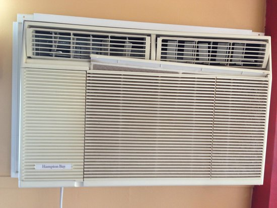 Desert Lily: old broken air conditioner