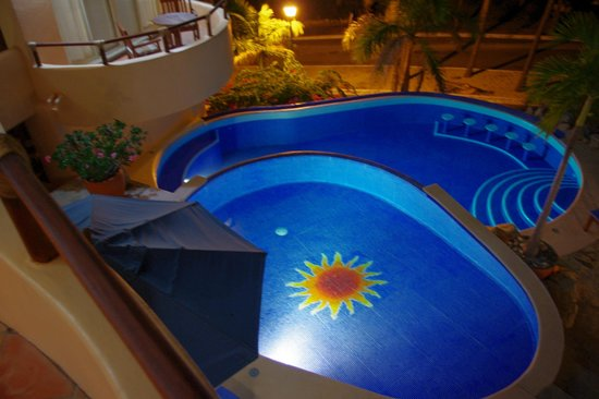Villa Pacifico: Night time view of pool, and suite balcony