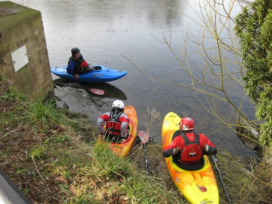 Kayakers on River Dee as seen from the Corn Mill