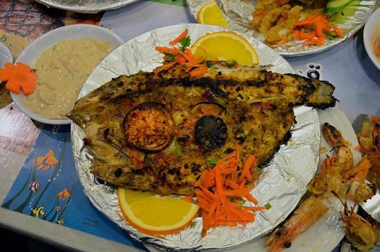 Balbaa Village: Golden Groupers fish (Wa'ar - وقار) cooked in oven, they call this way of cooking Sangari