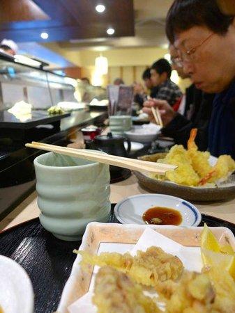 Sushizanmai Tsukijiekimae-ten: At the sushi bar 2nd floor.