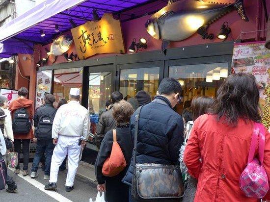 Sushizanmai Tsukijiekimae-ten: Long queue in line waiting to get in.