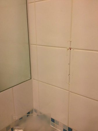 Holiday Inn London-Heathrow M4, Jct. 4: Old fixture holes in wall. No attempt to hide them