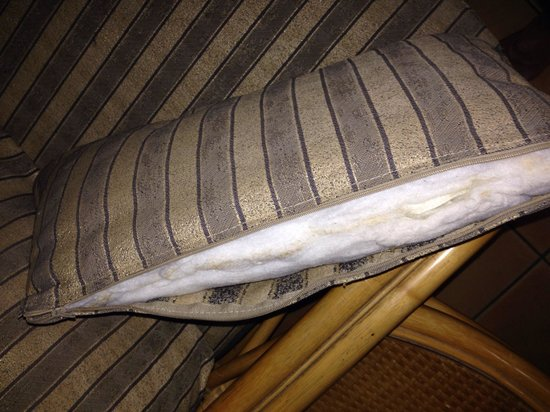 Breakfree Alexandra Beach Premier Resort: Sofa pillows, broken zip, been broken so long that dust has accumulated along the opening