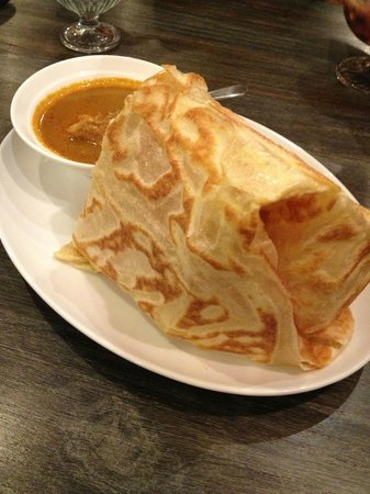 Penang Bistro - Kebon Sirih : Roti Canai served with a bowl of Curry