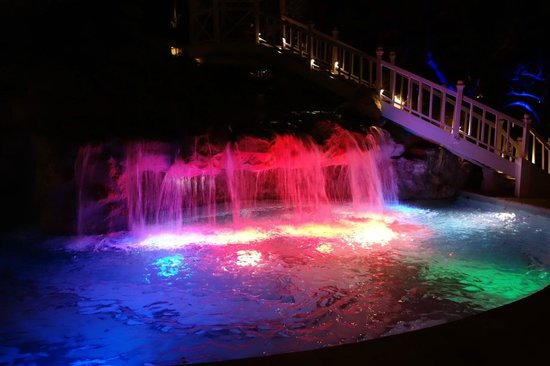 Sandals Regency La Toc: Waterfall of main pool at night