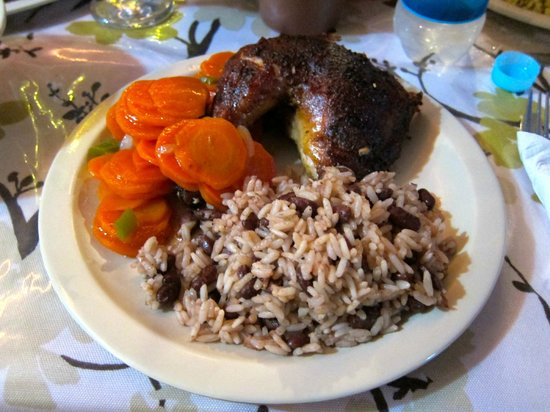 Creole's Rotisserie Chicken: A quarter of Roast Chicken with Carrots and Beans & Rice